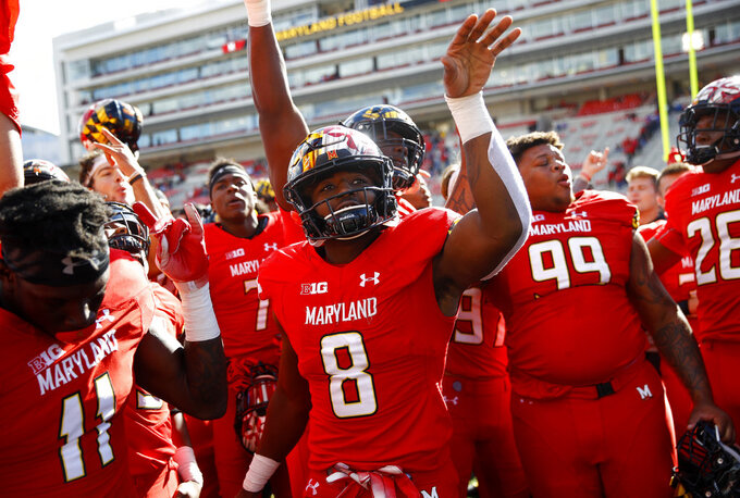 Maryland running back Tayon Fleet-Davis (8) celebrates with teammates after an NCAA college football game against Rutgers, Saturday, Oct. 13, 2018, in College Park, Md. Maryland won 34-7. (AP Photo/Patrick Semansky)