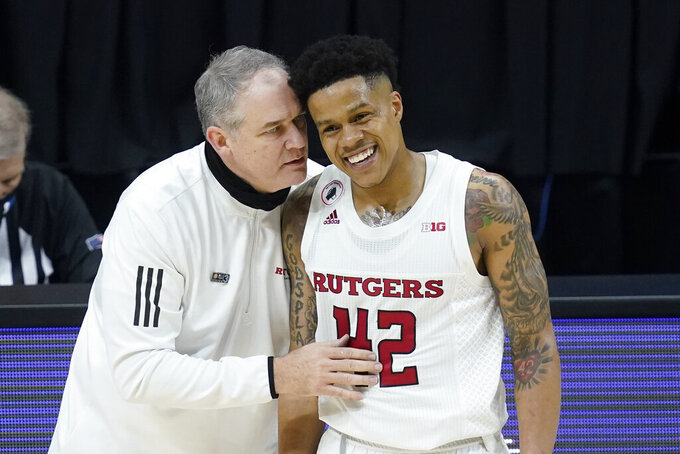Rutgers head coach Steve Pikiell talks with Jacob Young during the second half of an NCAA college basketball game against Indiana at the Big Ten Conference tournament, Thursday, March 11, 2021, in Indianapolis. Rutgers won 61-50. (AP Photo/Darron Cummings)