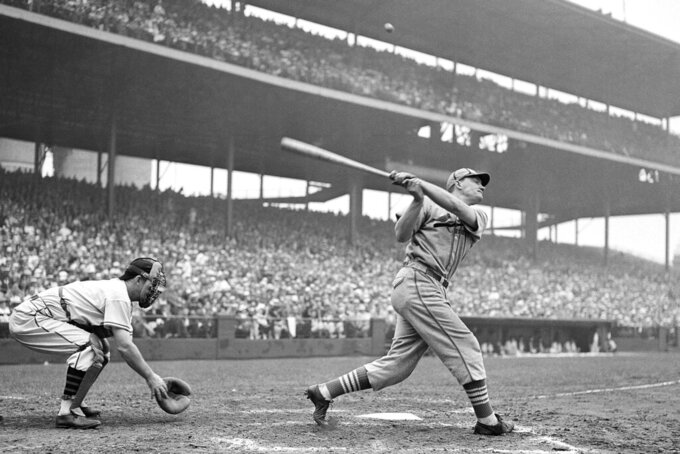 FILE - In this 1936, file photo, Johnny Mize of the St. Louis Cardinals swings during a baseball game. (AP Photo/File)