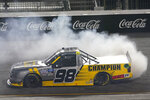 Grant Enfinger does a burnout as he celebrates his victory in the NASCAR Truck Series auto race Thursday, Sept. 10, 2020, in Richmond, Va. (AP Photo/Steve Helber)