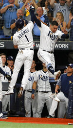 Tampa Bay Rays' Willy Adames (1) celebrates his solo home run against the Houston Astros with right fielder Avisail Garcia, right, in the fourth inning of Game 4 of a baseball American League Division Series, Tuesday, Oct. 8, 2019, in St. Petersburg, Fla. (AP Photo/Scott Audette)