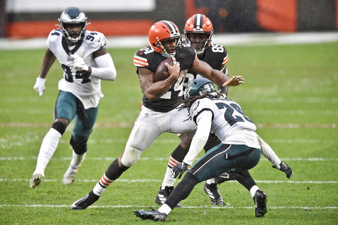 Cleveland Browns running back Nick Chubb, center, rushes during the second half of an NFL football game against the Philadelphia Eagles, Sunday, Nov. 22, 2020, in Cleveland. (AP Photo/David Richard)