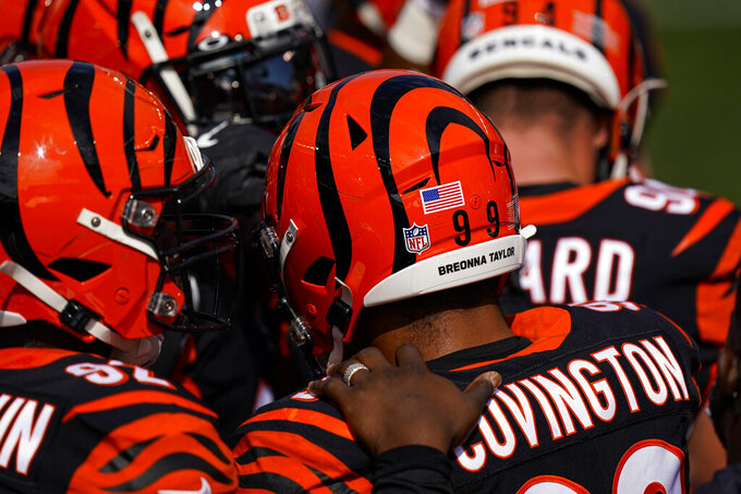 Cincinnati Bengals defensive tackle Christian Covington (99) carries the name of Breonna Taylor on his helmet before an NFL football game against the Jacksonville Jaguars in Cincinnati, Sunday, Oct. 4, 2020. (AP Photo/Bryan Woolston)