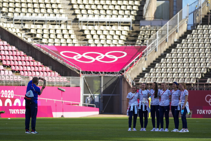 Players of Britain have their photo taken prior to their women's quarterfinal soccer match against Australia at the 2020 Summer Olympics, Friday, July 30, 2021, in Kashima, Japan. (AP Photo/Fernando Vergara)