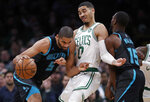 Boston Celtics forward Jayson Tatum (0) gets caught in a pick, set by Charlotte Hornets guard Kemba Walker (15), as Hornets forward Nicolas Batum (5) drives to the basket during the first quarter of an NBA basketball game in Boston, Wednesday, Jan. 30, 2019. (AP Photo/Charles Krupa)