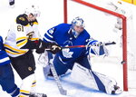Toronto Maple Leafs goaltender Frederik Andersen (31) makes a save on a deflection by Boston Bruins left wing Rick Nash (61) during third period NHL, round one playoff hockey action in Toronto on Monday, April 16, 2018. (Nathan Denette/The Canadian Press via AP)