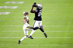 Las Vegas Raiders wide receiver Bryan Edwards (89) catches a pass over New Orleans Saints cornerback Marshon Lattimore (23) during the first half of an NFL football game, Monday, Sept. 21, 2020, in Las Vegas. (AP Photo/Isaac Brekken)