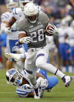 Northwestern's Jeremy Larkin breaks a tackle by Duke's Marquis Waters during the first half of an NCAA college football game Saturday, Sept. 8, 2018, in Evanston, Ill. (AP Photo/Jim Young)