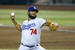 Los Angeles Dodgers relief pitcher Kenley Jansen throws a pitch against the Arizona Diamondbacks during the ninth inning of a baseball game Sunday, Aug. 2, 2020, in Phoenix. The Dodgers defeated the Diamondbacks 3-0. (AP Photo/Ross D. Franklin)