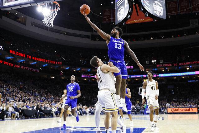 Seton Hall's Myles Powell (13) goes up for a shot against Villanova Collin Gillespie (2) during the second half of an NCAA college basketball game, Saturday, Feb. 8, 2020, in Philadelphia. (AP Photo/Matt Slocum)
