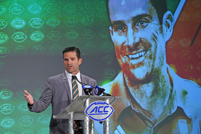 Miami head coach Manny Diaz speaks during the Atlantic Coast Conference NCAA college football media days in Charlotte, N.C., Thursday, July 18, 2019. (AP Photo/Chuck Burton)