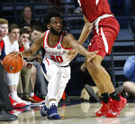 Mississippi guard D.C. Davis (20) takes a low stance as he dribbles past Arkansas guard Mason Jones, right, during the second half of the NCAA college basketball game in Oxford, Miss., Saturday, Jan. 19, 2019. Mississippi won 84-67. (AP Photo/Rogelio V. Solis)