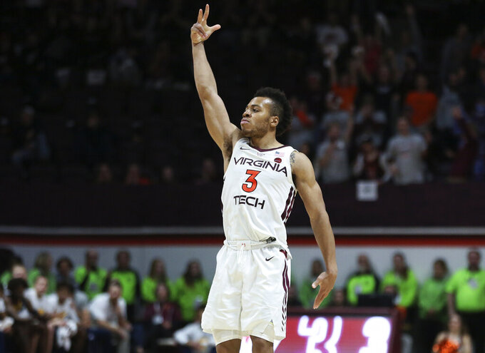 Virginia Tech's Wabissa Bede (3) celebrates a 3-point basket in the final minutes of an NCAA college basketball game against Chattanooga, Wednesday, Dec. 11, 2019, in Blacksburg, Va. Virginia Tech won 63-58. (Matt Gentry/The Roanoke Times via AP)