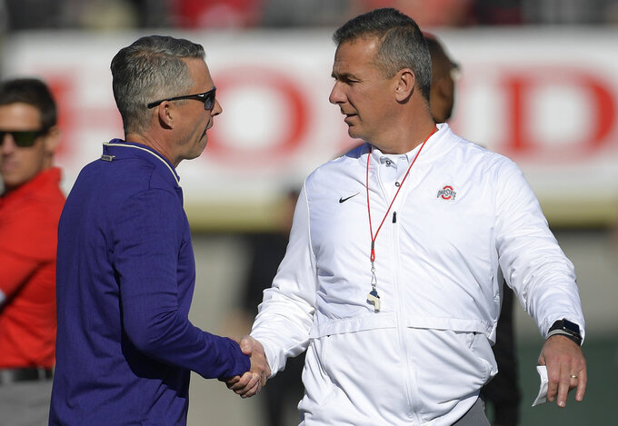 Ohio State head coach Urban Meyer, right, and Washington head coach Chris Petersen shake hands before the Rose Bowl NCAA college football game Tuesday, Jan. 1, 2019, in Pasadena, Calif. (AP Photo/Mark J. Terrill)