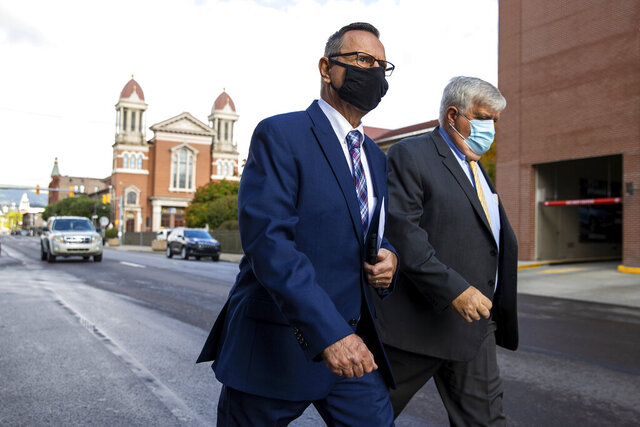 Former Scranton, Pa. mayor Bill Courtright, left, arrives with his attorney Paul Walker for sentencing at the William J. Nealon Federal Building and U.S. Courthouse in downtown Scranton, Pa. on Friday, Oct. 2, 2020. Courtright has been sentenced to seven years in federal prison on charges that he shook down businesses for bribes and campaign contributions. Bill Courtright resigned last year as mayor of the city of 78,000 and pleaded guilty to bribery, extortion and conspiracy. (Christopher Dolan/The Times-Tribune via AP)