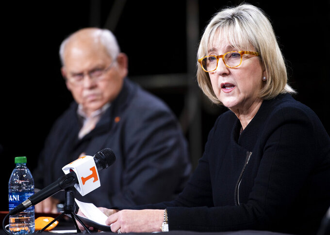 "University of Tennessee Chancellor Donde Plowman speaks during a press conference in Knoxville, Tenn., Monday, Jan. 18, 2021, as Tennessee Athletic Director Phillip Fulmer looks on. Tennessee has fired football coach Jeremy Pruitt, two assistants and seven members of the Volunteers' recruiting and support staff for cause after an internal investigation found what the university chancellor called ""serious violations of NCAA rules.""  Chancellor Donde Plowman said Pruitt was responsible for overseeing the program. (Brianna Paciorka/Knoxville News Sentinel via AP)"