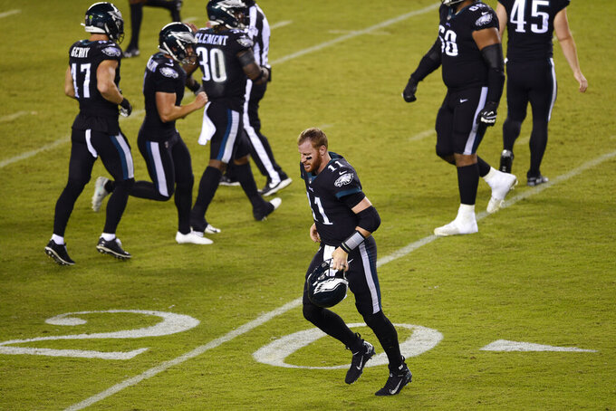 Philadelphia Eagles' Carson Wentz runs off the field during the second half of an NFL football game against the New York Giants, Thursday, Oct. 22, 2020, in Philadelphia. (AP Photo/Derik Hamilton)