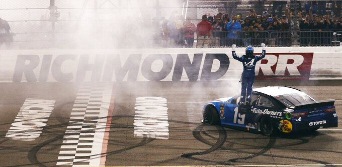 Martin Truex Jr. celebrates his win in the NASCAR Cup Series auto race at Richmond Raceway in Richmond, Va., Saturday, April 13, 2019. (AP Photo/Steve Helber)
