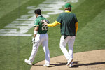 Oakland Athletics' Ramon Laureano is walked off the field after charging the Houston Astros dugout after being hit by a pitch thrown by Humberto Castellanos in the seventh inning of a baseball game Sunday, Aug. 9, 2020, in Oakland, Calif. (AP Photo/Ben Margot)