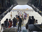 FILE - In this Wednesday, Aug. 18, 2021 file photo provided by the Spanish Defence Ministry and taken in Kabul, Afghanistan, people board a Spanish airforce A400 plane as part of an evacuation plan at Kabul airport in Afghanistan, Wednesday Aug. 18, 2021. (Spanish Defence Ministry via AP, File)