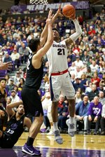 Gonzaga forward Rui Hachimura, right, shoots over Portland forward Hugh Hogland during the first half of an NCAA college basketball game in Portland, Ore., Saturday, Jan. 19, 2019. (AP Photo/Craig Mitchelldyer)