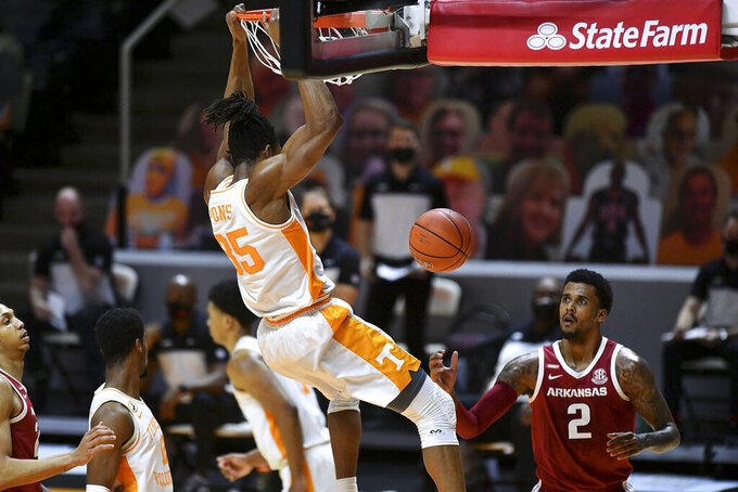 Tennessee's Yves Pons (35) dunks the ball against Arkansas' Vance Jackson Jr. (2) during an NCAA college basketball game Wednesday, Jan. 6, 2021, in Knoxville, Tenn. (Saul Young/Knoxville News Sentinel via AP, Pool)