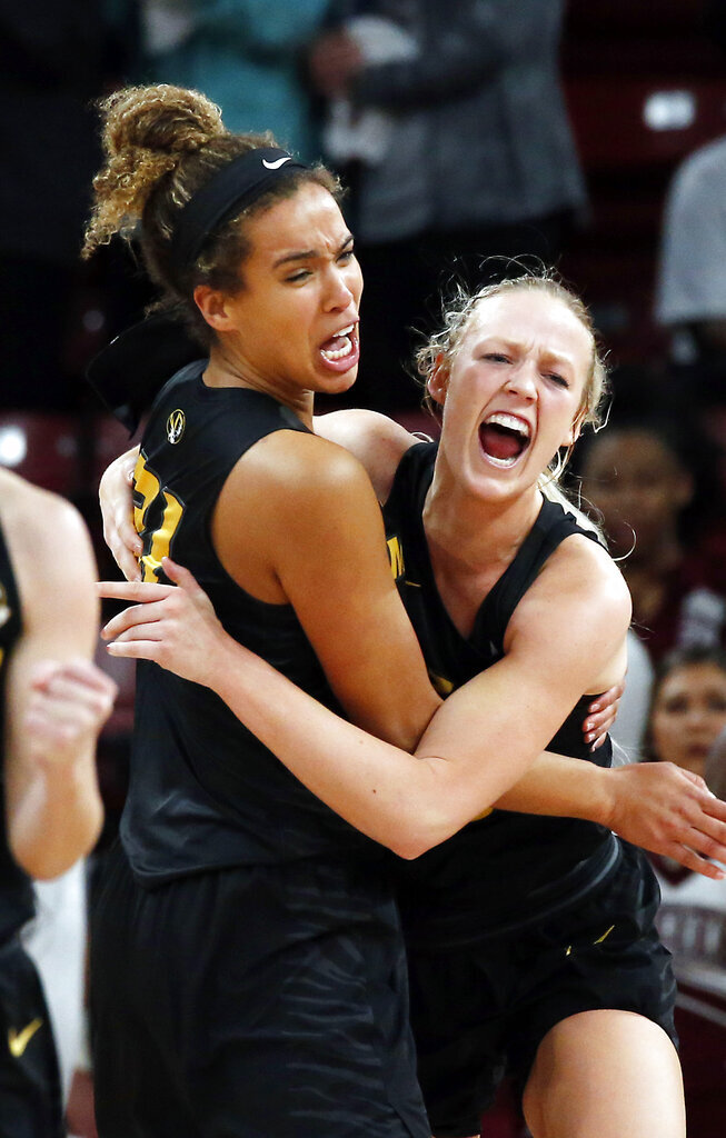 Missouri forward Cierra Porter, left, hugs guard Sophie Cunningham after the team's 75-67 win over Mississippi State in an NCAA college basketball game Thursday, Feb. 14, 2019, in Starkville, Miss. (AP Photo/Rogelio V. Solis)