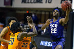 TCU guard RJ Nembhard (22) goes to the basket during the first half of the NCAA college basketball game against Oklahoma State in Stillwater, Okla., Wednesday, Dec. 16, 2020. (AP Photo/Mitch Alcala)