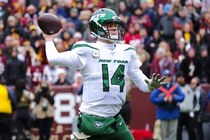 New York Jets quarterback Sam Darnold (14) throws a touchdown pass in the first half of an NFL football game against the Washington Redskins, Sunday, Nov. 17, 2019, in Landover, Md. (AP Photo/Mark Tenally)
