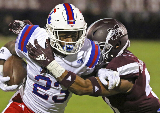 Louisiana Tech running back Jaqwis Dancy (23) tries to gain additional yards as Mississippi State safety Mark McLaurin (41) tackles him during the first half of an NCAA college football game on Saturday, Nov. 3, 2018, in Starkville, Miss. (AP Photo/Jim Lytle)