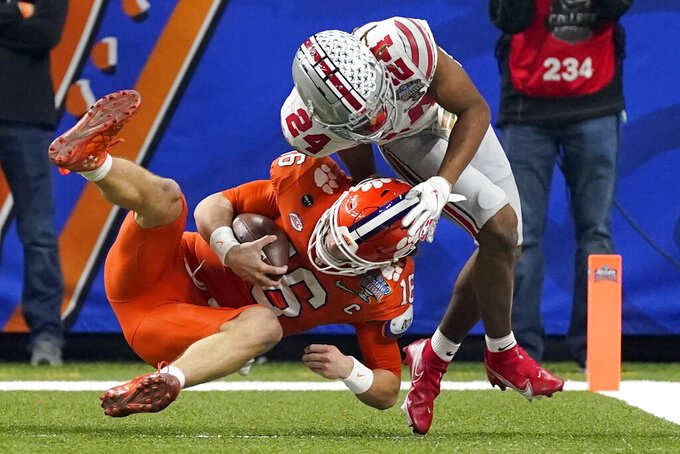 Clemson quarterback Trevor Lawrence scores past Ohio State cornerback Shaun Wade during the first half of the Sugar Bowl NCAA college football game Friday, Jan. 1, 2021, in New Orleans. (AP Photo/John Bazemore)