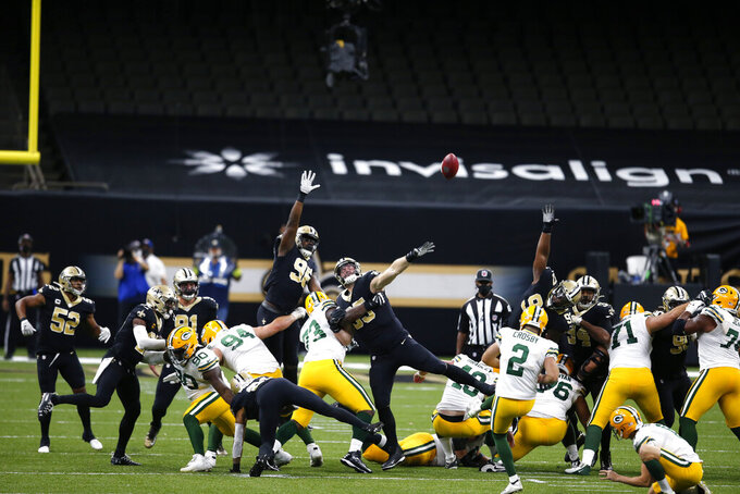 Green Bay Packers kicker Mason Crosby (2) kicks a field goal in the second half of an NFL football game against the New Orleans Saints in New Orleans, Sunday, Sept. 27, 2020. (AP Photo/Butch Dill)