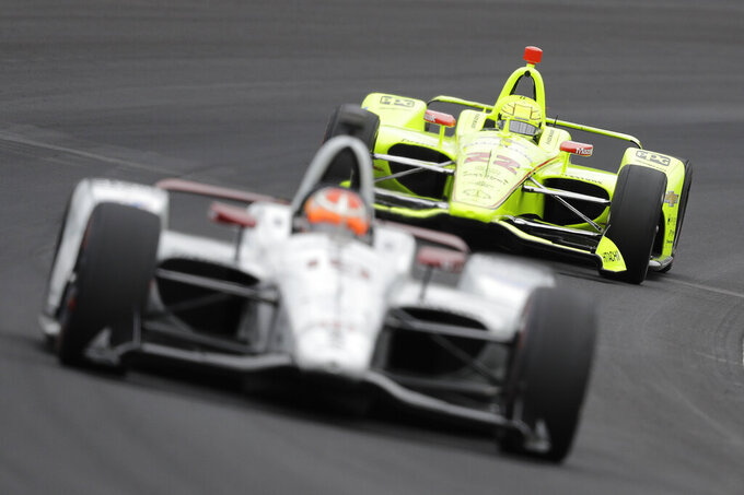 Simon Pagenaud, of France, follows Santino Ferrucci into turn one during practice for the Indianapolis 500 IndyCar auto race at Indianapolis Motor Speedway, Monday, May 20, 2019, in Indianapolis. (AP Photo/Darron Cummings)