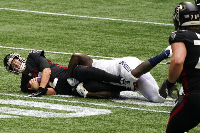 Atlanta Falcons quarterback Matt Ryan (2) is sacked by Seattle Seahawks defense during the second half of an NFL football game, Sunday, Sept. 13, 2020, in Atlanta. (AP Photo/John Bazemore)