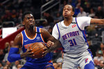 New York Knicks forward Bobby Portis, left, looks towards the basket as Detroit Pistons forward John Henson (31) defense during the first half of an NBA basketball game, Saturday, Feb. 8, 2020, in Detroit. (AP Photo/Carlos Osorio)