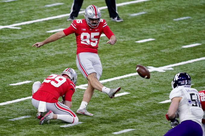 Ohio State place kicker Blake Haubeil kicks a 43-yard field goal during the first half of the Big Ten championship NCAA college football game against Northwestern, Saturday, Dec. 19, 2020, in Indianapolis. (AP Photo/Darron Cummings)