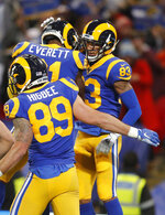 Los Angeles Rams wide receiver Josh Reynolds, right, celebrates with teammates after scoring against the Cincinnati Bengals during the first half of an NFL football game, Sunday, Oct. 27, 2019, at Wembley Stadium in London. (AP Photo/Frank Augstein)