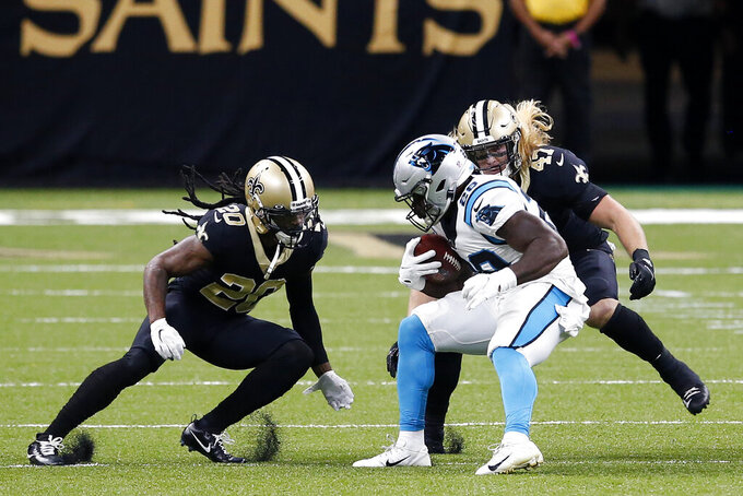 Carolina Panthers running back Mike Davis (28) carries against New Orleans Saints cornerback Janoris Jenkins (20) and middle linebacker Alex Anzalone (47) in the first half of an NFL football game in New Orleans, Sunday, Oct. 25, 2020. (AP Photo/Butch Dill)