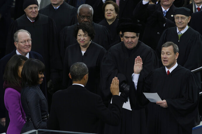 FILE - In this Jan. 21, 2013, file photo Chief Justice John Roberts, right, reads the oath of office to President Barack Obama at the ceremonial swearing-in at the U.S. Capitol during the 57th Presidential Inauguration in Washington. (AP Photo/Paul Sancya, File)