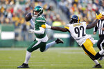 New York Jets quarterback Sam Darnold (14) looks to pass in front of Pittsburgh Steelers linebacker Ola Adeniyi (92) in the second half of an NFL football game, Sunday, Dec. 22, 2019, in East Rutherford, N.J. (AP Photo/Adam Hunger)