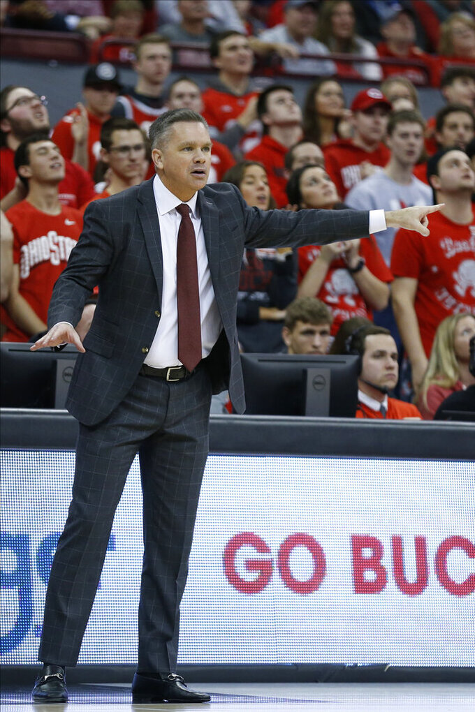 Ohio State head coach Chris Holtmann instructs his team against Purdue during the first half of an NCAA college basketball game Saturday, Feb. 15, 2020, in Columbus, Ohio. Ohio State beat Purdue 68-52. (AP Photo/Jay LaPrete)