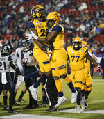 Kent State running back Xavier Williams (18) is congratulated by wide receiver Isaiah McKoy (23) after scoring a touchdown against Utah State during the first half of the Frisco Bowl NCAA college football game Friday, Dec. 20, 2019, in Frisco, Texas. (AP Photo/Brandon Wade)