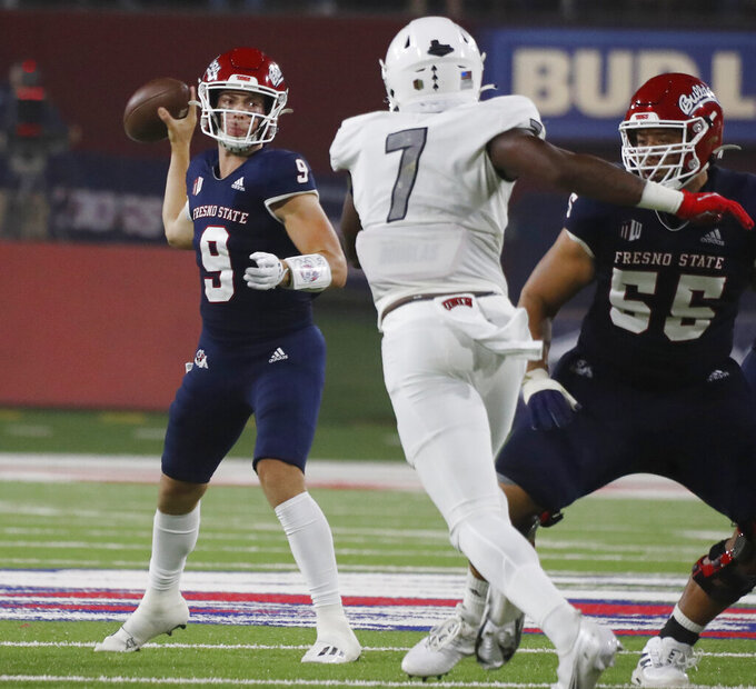 Fresno State quarterback Jake Haener drops back to pass against UNLV during the first half of an NCAA college football game in Fresno, Calif., Friday, Sept. 24, 2021. (AP Photo/Gary Kazanjian)