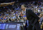 Kentucky head coach John Calipari yells toward an official during the second half of a men's NCAA tournament college basketball Midwest Regional semifinal game against Houston Friday, March 29, 2019, in Kansas City, Mo. (AP Photo/Charlie Riedel)