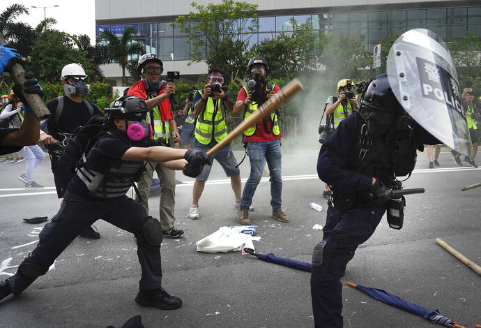Police and demonstrators clash during a protest in Hong Kong, Saturday, Aug. 24, 2019. Chinese police said Saturday they released an employee at the British Consulate in Hong Kong as the city's pro-democracy protesters took to the streets again, this time to call for the removal of
