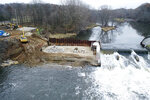 In this Thursday, Dec. 5, 2019 photo provided by the Environmental Protection Agency shows an aerial view of the dam stabilization project at the Trowbridge Dam on the Kalamazoo River near Allegan, Mich., in southwestern Michigan. The aging dam will be taken down under an agreement reached between federal officials and NCR Corp., one of the companies whose paper mills polluted the river with toxic PCBs in the last century. (Paul Ruesch/Environmental Protection Agency via AP)