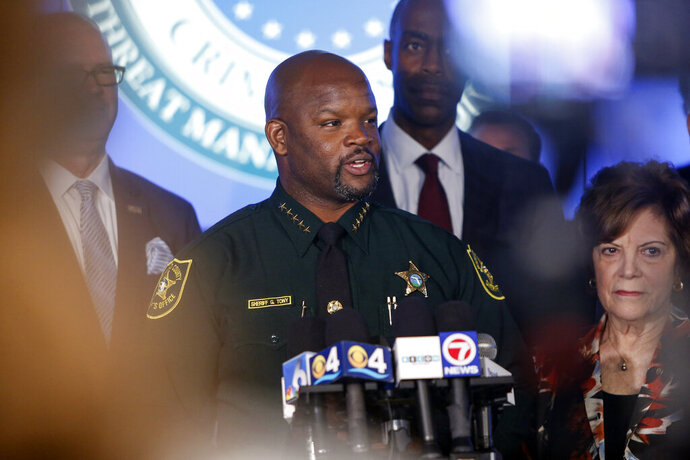 Broward County Sheriff Gregory Tony speaks at a news conference announcing the opening a new 2,600-square-foot strategic command and intelligence center, Tuesday, Aug. 13, 2019, in Fort Lauderdale, Fla. The center, located at the Broward County Sheriff's Office, is expected to monitor live video feeds at more than 260 public schools and administrative buildings across the county. (AP Photo/Ellis Rua)