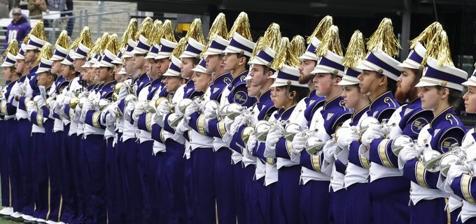 Members of the Washington marching band wait to perform before an NCAA college football game against Colorado, Saturday, Oct. 20, 2018, in Seattle. (AP Photo/Ted S. Warren)