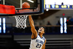 Villanova's Jermaine Samuels dunks the ball during the first half of an NCAA college basketball game against Georgetown, Sunday, Feb. 7, 2021, in Villanova, Pa. (AP Photo/Matt Slocum)