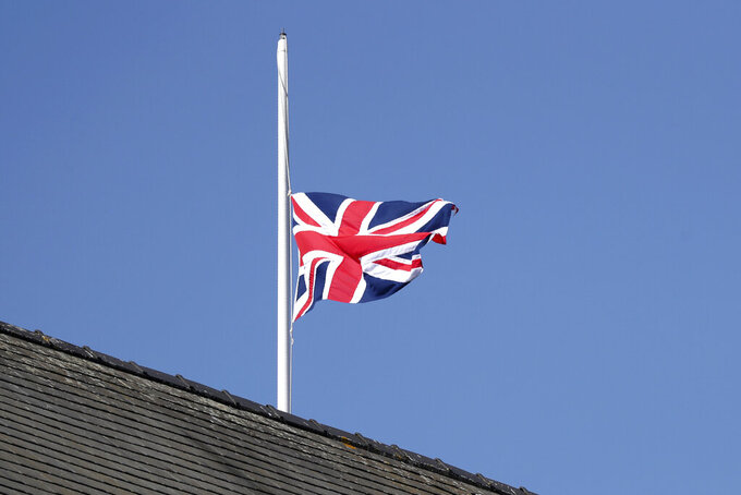 The Union Jack flies at half mast behind the stands in honour of the late Prince Philip, Duke of Edinburgh, during races on the second day of the Grand National Horse Racing meeting at Aintree racecourse, near Liverpool, England, Friday April 9, 2021. (AP Photo/Scott Heppell, Pool)